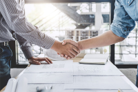 A Contractor's Guide to IR35 - Part 2 - Contractor agreeing contract with client and shaking hands.